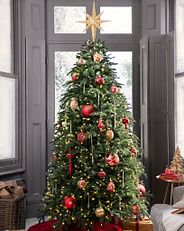 Balsam Hill's Nordmann Fir artificial Christmas tree decorated with red and gold baubles