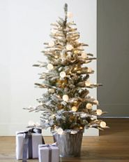 potted Christmas tree with globe lights