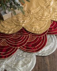 Christmas tree skirts in gold, red, and white