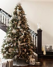 decorated Christmas tree beside the stairs