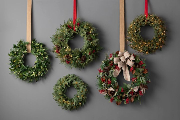 pre-lit artificial greenery wreaths of different sizes with various decorative accents