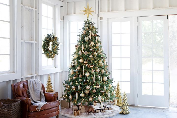 elegant Christmas tree decorations set up in the corner of a white room