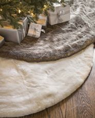 pair of faux fur Christmas tree skirts in ivory and stone colors