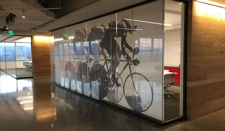 ImageShade of bike rider on Mecho solar shade cloth located in Mecho headquarters