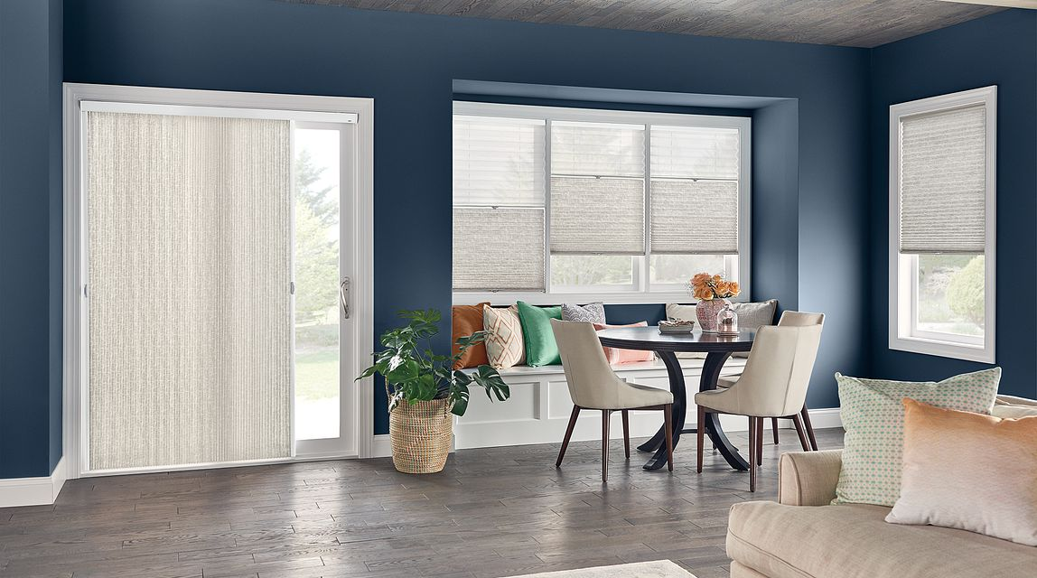 "Windows: Combo Shade with Cordless Lift: 3/4"" Single Cell Shades: Impresario, Sandstone Gray 0590 (bottom) and Intuition, White Blossom 5800 (top). Door: 3/4"" Single Cell VertiCell Cellular Shade: Impresario, Sandstone Gray 0590"