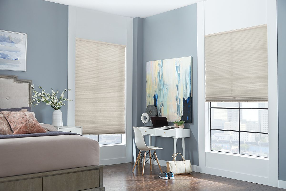 Cellular shades in blue bedroom