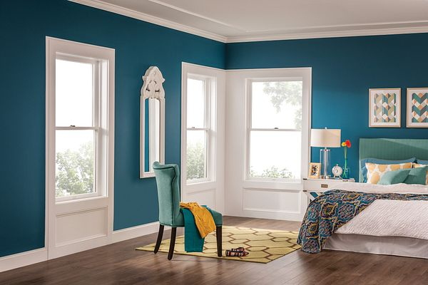 A bedroom without window treatments