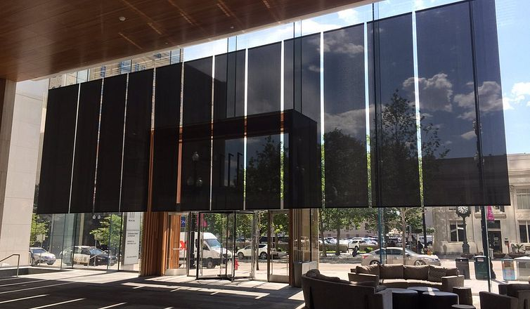 Black fixed shades with lower openness factor in commercial building