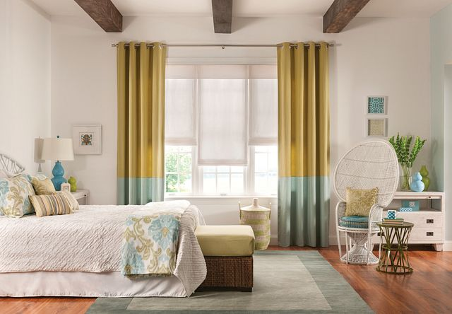 "Draperies with Grommet Top and Color Blocking: Top: Coastal, Caribbean 2465, Bottom: Coastal, Breeze 2466; Seamless Roman Shades: Three on One Headrail with Continuous-loop Lift and 8"" Valance: Ludlow, City Snow 0644; Rectangular Pillows: Bazaar, Mardi Gras 1103; Square Pillows: Concorde, Saltwater 3260"