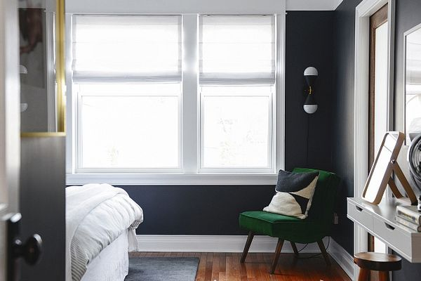 A bedroom with Bali motorized shades
