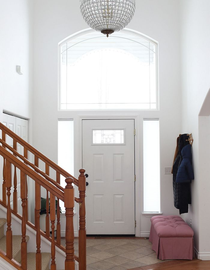 An entryway without window treatments
