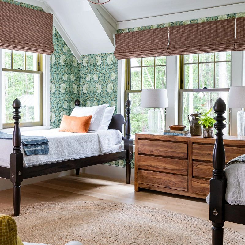 Guest room in the idea house featuring natural shades.