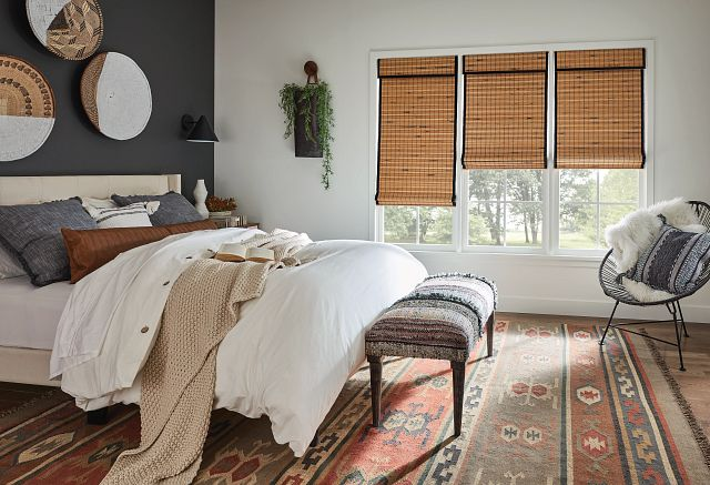 Bedroom featuring Bali Natural Shades in Standard Roman Style with Cordless Lift