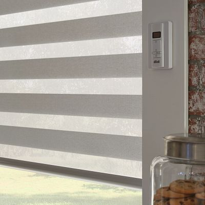 Bali Layered Shades in a window with motorization
