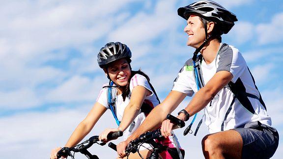 Couple biking outdoors