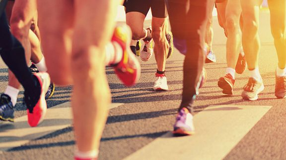Running feet on the pavement.