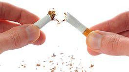 Hands breaking a cigarette in half