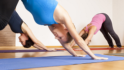 Image of women doing downward facing dog in their yoga pose