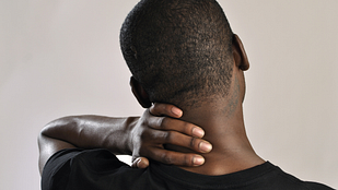 Image of a person holding the back of their neck