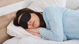 Woman sleeping  on her side with eye mask