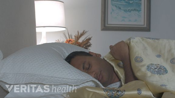 Man sleeping on his side with a supportive pillow