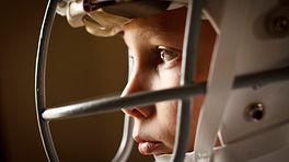 Young boy wearing a football helmet