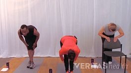 Three people doing a standing hamstring stretch