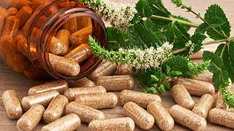 Spilled bottle of herbal supplements.