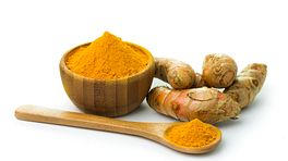 Turmeric root and powder in a bowl