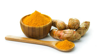 Image of turmeric root and powder in a bowl