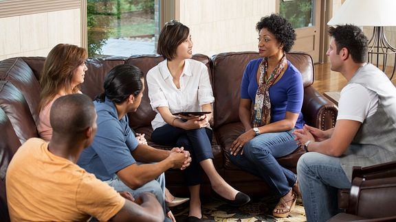 Groups of friends talking on the couch