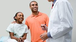 teen and parent at doctor consultation