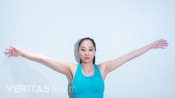 Woman doing the back burn exercise for neck pain