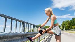 Woman adjusting knee brace