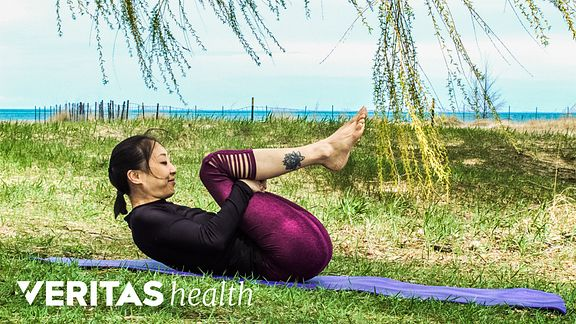 Woman doing back flexion exercise