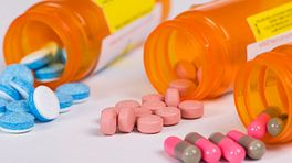 Prescription bottles scattered on the table.