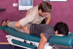 image of chiropractor performing a lumbar spine adjustment