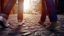 Walking feet on a cobblestone street.