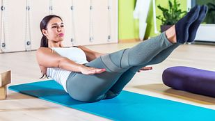 Woman doing a Pilates ab exercise