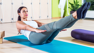 Image of woman doing a Pilates ab exercise