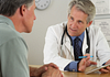 Image of a doctor going over paperwork with a male patient