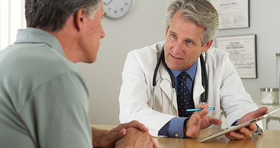 Patient consults with doctor about treatment plan.