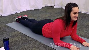 Woman doing press up exercise for sciatica pain relief from Sacroiliac Joint Dysfunction