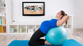 Pregnant woman performing exercises on an exercise ball.