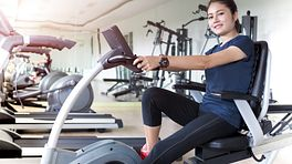 Woman riding a stationary bike at the gym
