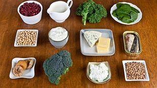 Food sources of calcium including broccoli, beans, spinach, milk, and cheese
