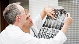 Doctors examining x-rays scans.