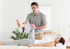 Image of physical therapist working with a patient's knee