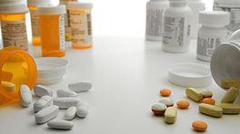 Prescription pills and bottles on the left, over the counter pills and bottles on the right