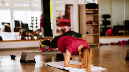 Woman doing a plank exercise in a class